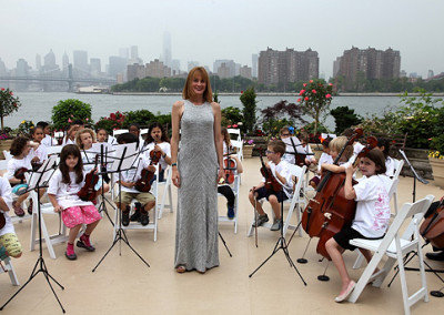 Anna Stampfli, Founder and CEO with Scarsdale Strings District Orchestra at the Celebration of Learning event