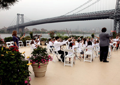 Students play at Giando on the Water in Brooklyn, NY - accompanied by the beautiful NYC skyline